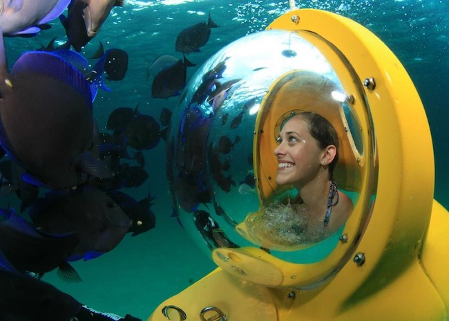 Kathleen happy to see all the wonders of the blue sea in Cozumel on a Mini Submarine tour.
